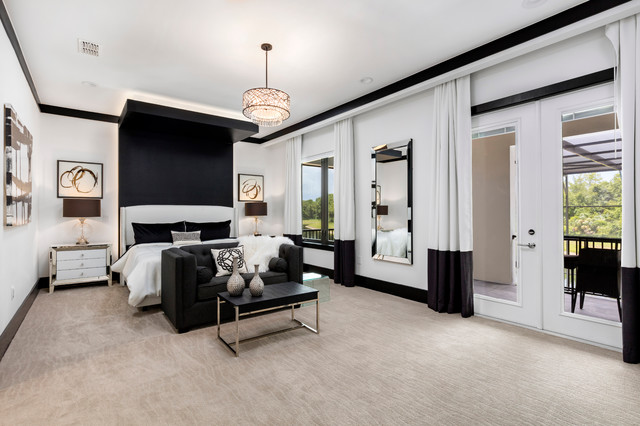 Large minimalist master carpeted bedroom photo in Orlando with white walls and no fireplace