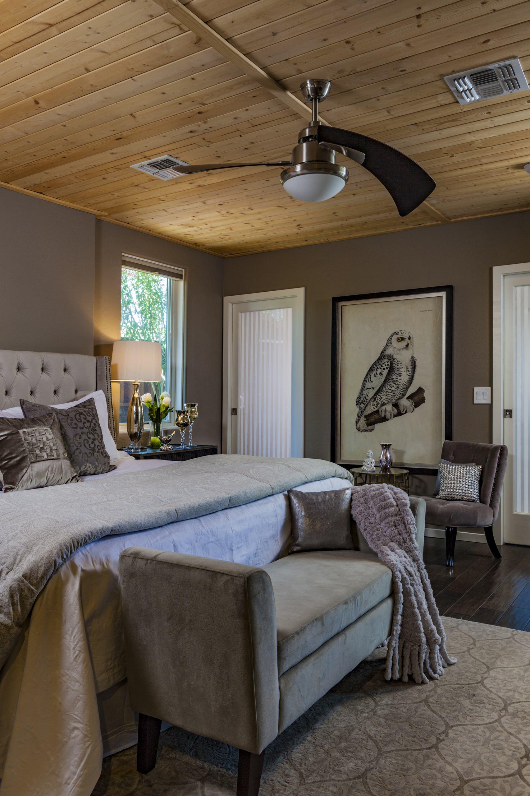 Mid-sized minimalist guest brown floor and dark wood floor bedroom photo in Phoenix with gray walls
