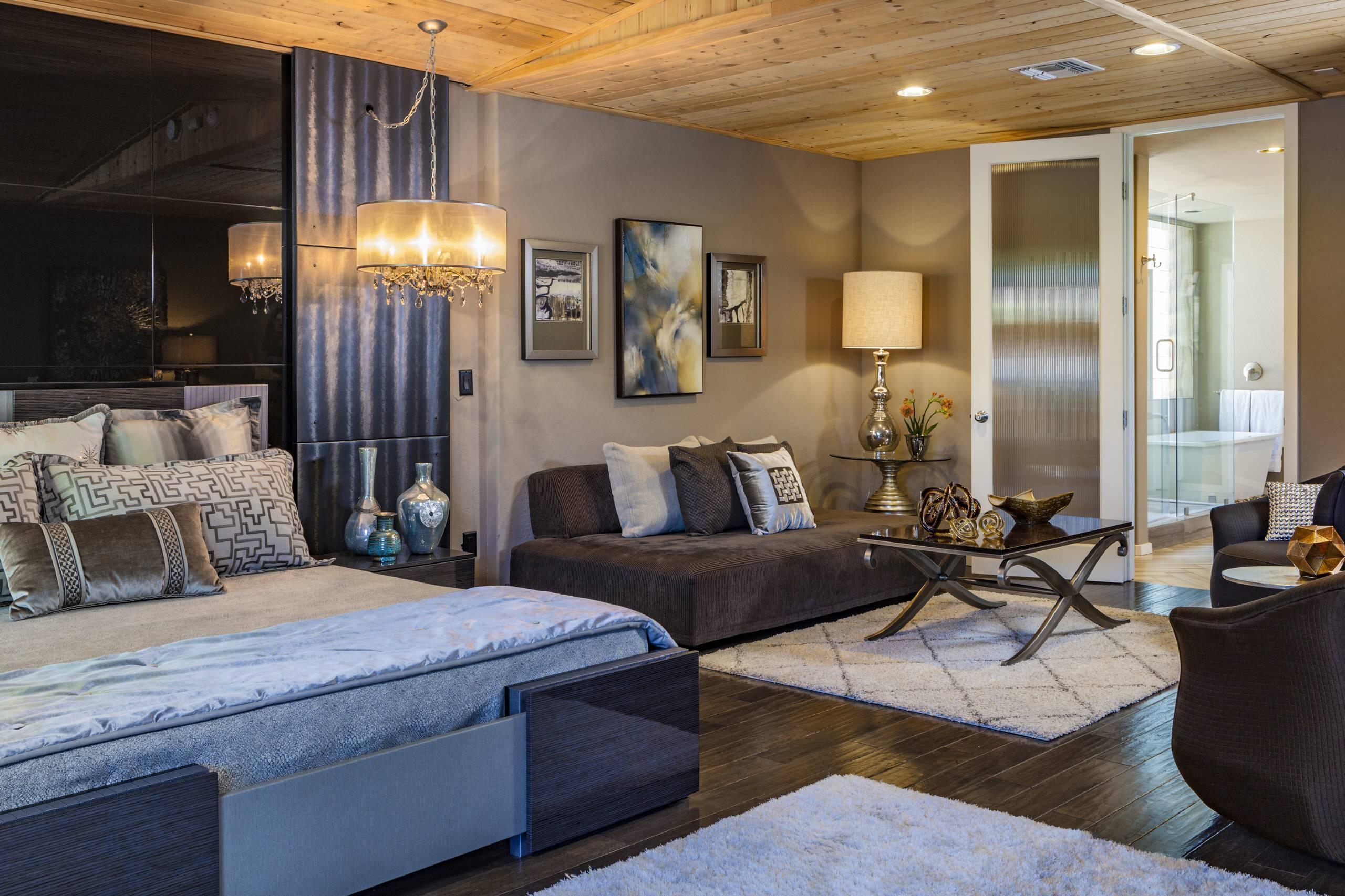 Bedroom - large modern master dark wood floor and brown floor bedroom idea in Phoenix with gray walls