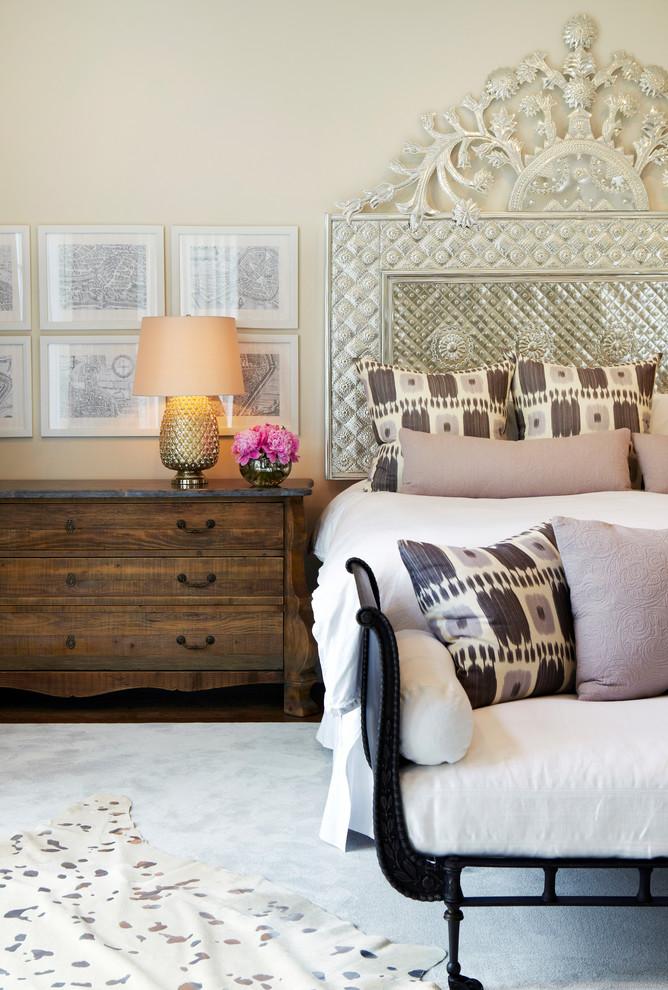 Bedroom - huge traditional master medium tone wood floor bedroom idea in New York with beige walls and no fireplace