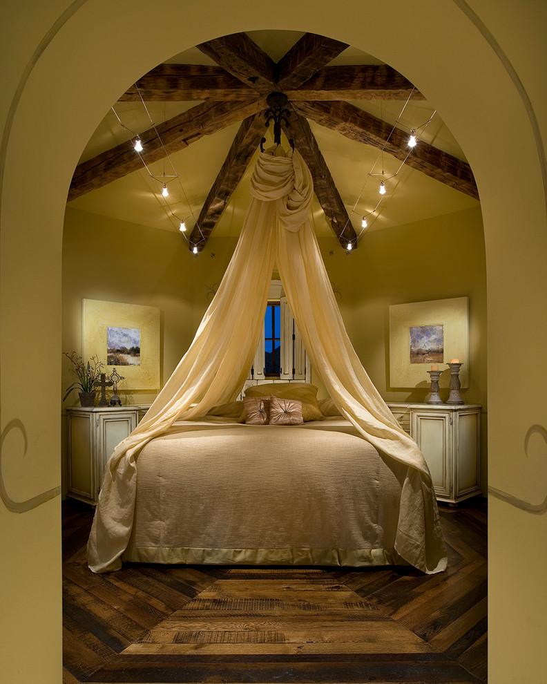 Example of a large classic guest dark wood floor and brown floor bedroom design in Orange County with beige walls