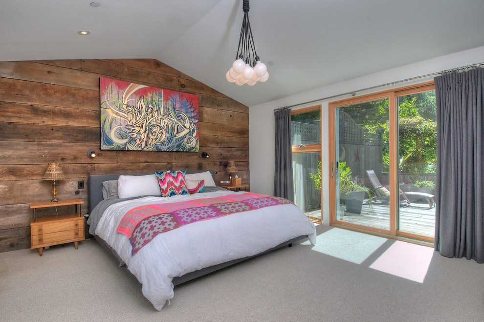 Example of a 1960s carpeted bedroom design in San Francisco with white walls