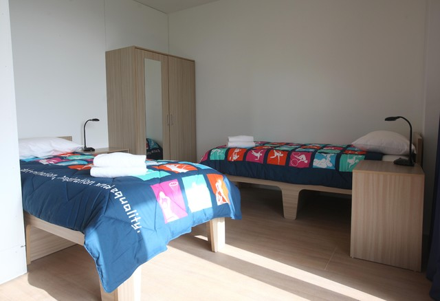 Olympic Village Athletes Village Apartment contemporary bedroom
