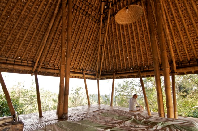 Open air living in the mountains of Bali tropical-bedroom