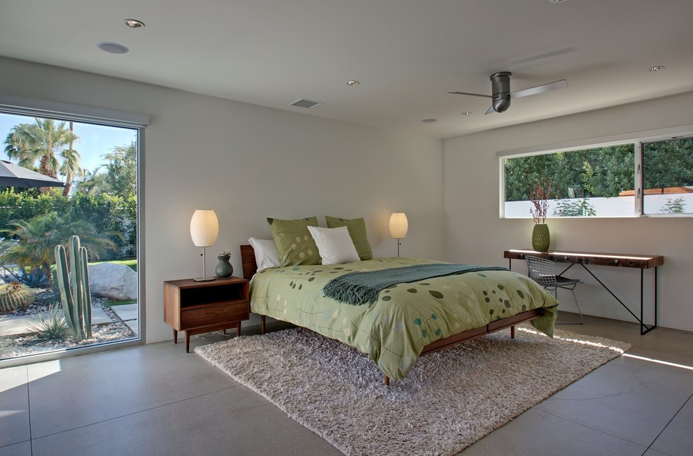 Bedroom - large 1960s guest concrete floor bedroom idea in Los Angeles with white walls