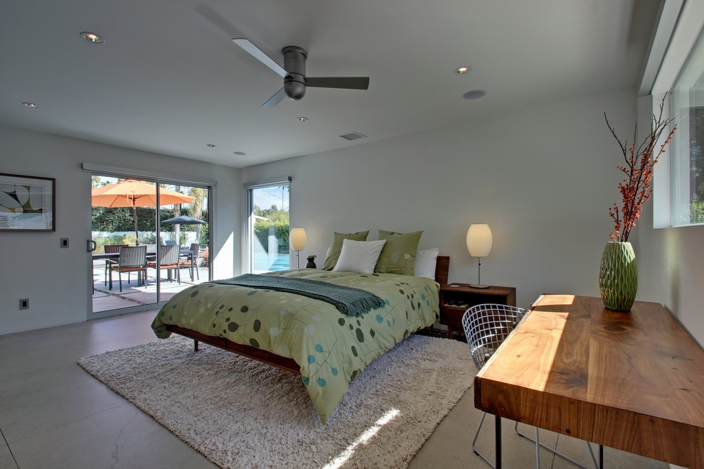 Bedroom - large mid-century modern guest concrete floor bedroom idea in Los Angeles with white walls