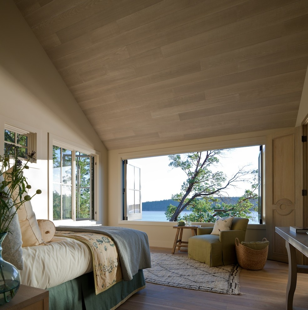 Mid-sized transitional medium tone wood floor bedroom photo in Seattle with gray walls
