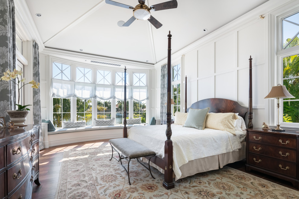 Large beach style master dark wood floor and brown floor bedroom photo in Tampa with white walls and no fireplace
