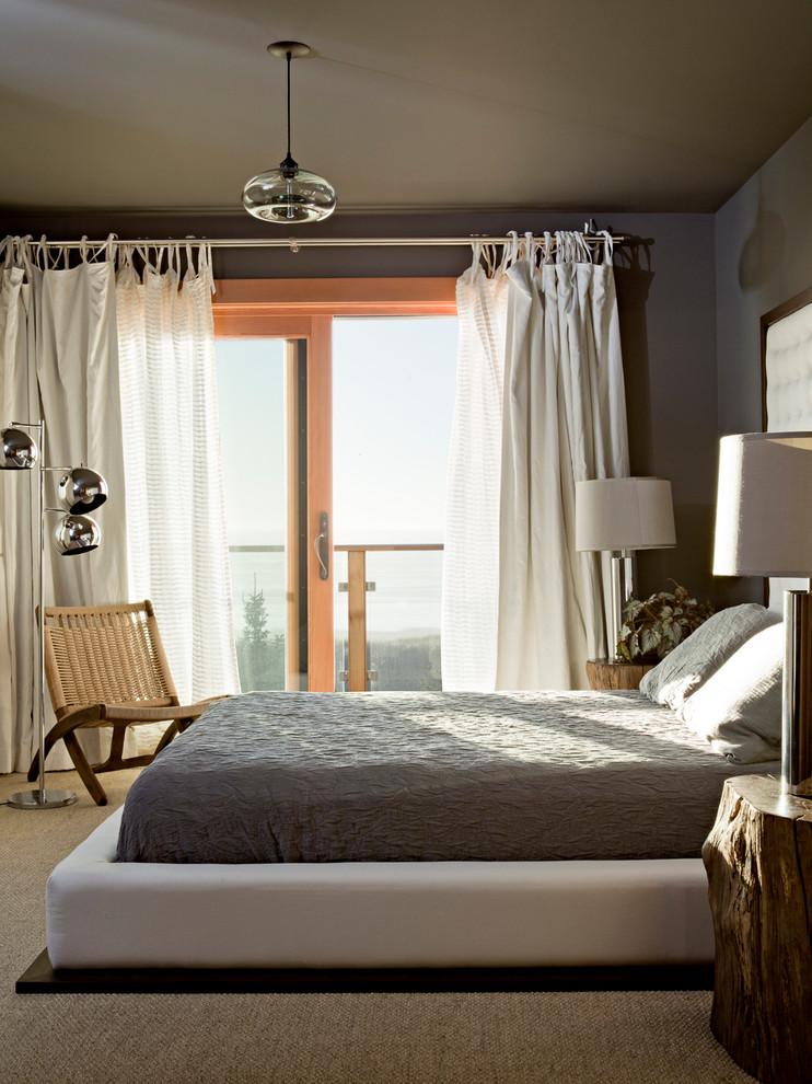 Bedroom - rustic bedroom idea in Portland with gray walls