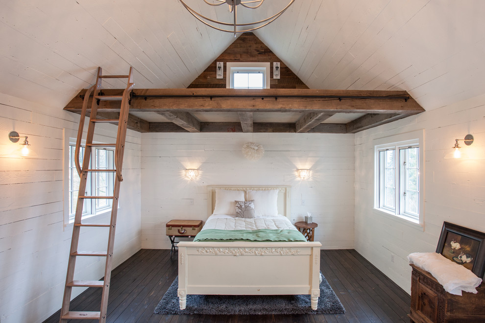 Example of a mid-sized country dark wood floor bedroom design in Other with white walls