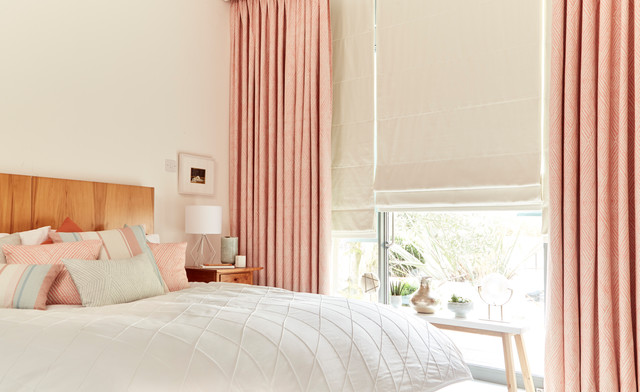 Origami Persimmon curtains and Tetbury Ivory Roman blinds from the Zen collectio bedroom