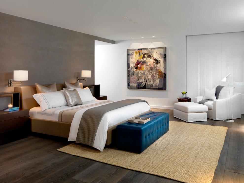Trendy medium tone wood floor bedroom photo in Miami with brown walls