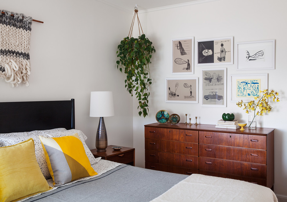 Inspiration for a small 1950s master medium tone wood floor bedroom remodel in San Francisco with white walls and no fireplace