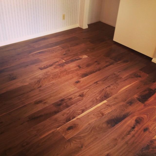 Owens walnut wood floor rustic bedroom orange county for Hardwood floor dealers