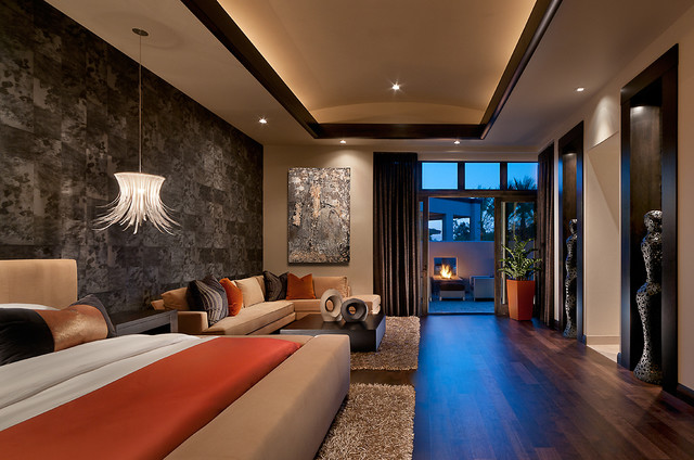 Example of an island style dark wood floor bedroom design in Phoenix with multicolored walls