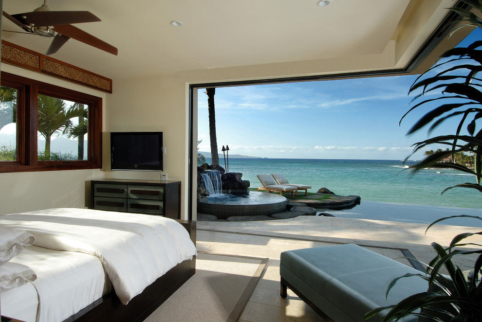 Example of an island style bedroom design in Hawaii with beige walls