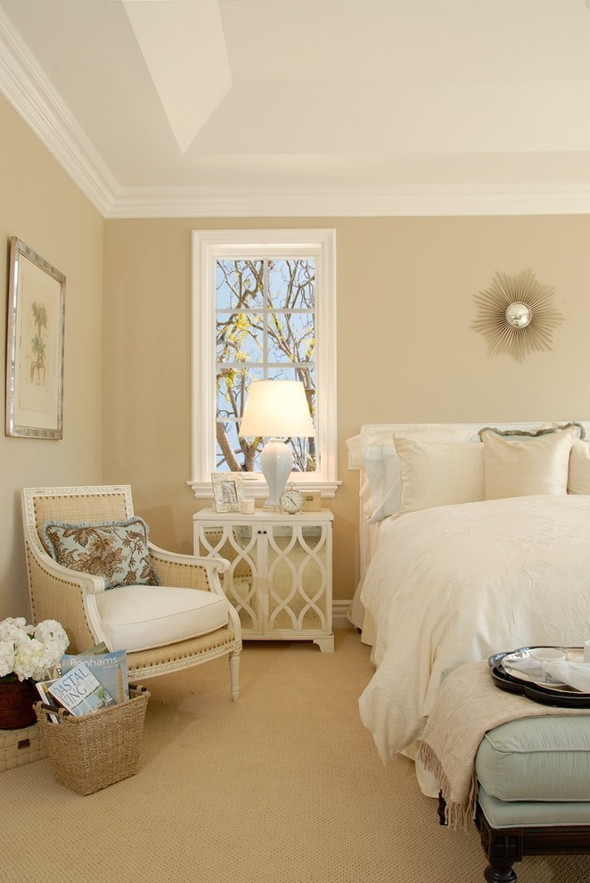 Beach style carpeted bedroom photo in Los Angeles with beige walls