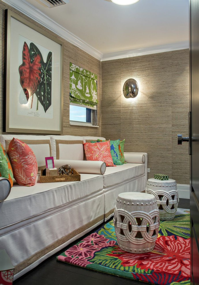 Inspiration for a mid-sized tropical dark wood floor and brown floor bedroom remodel in Miami with brown walls