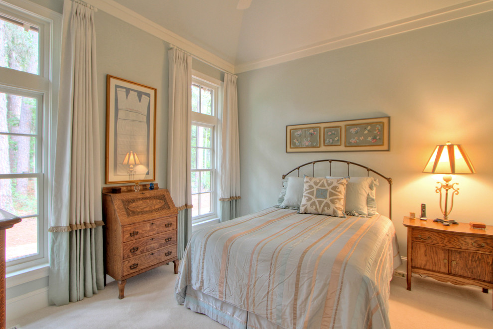 Elegant guest carpeted bedroom photo in Atlanta with blue walls