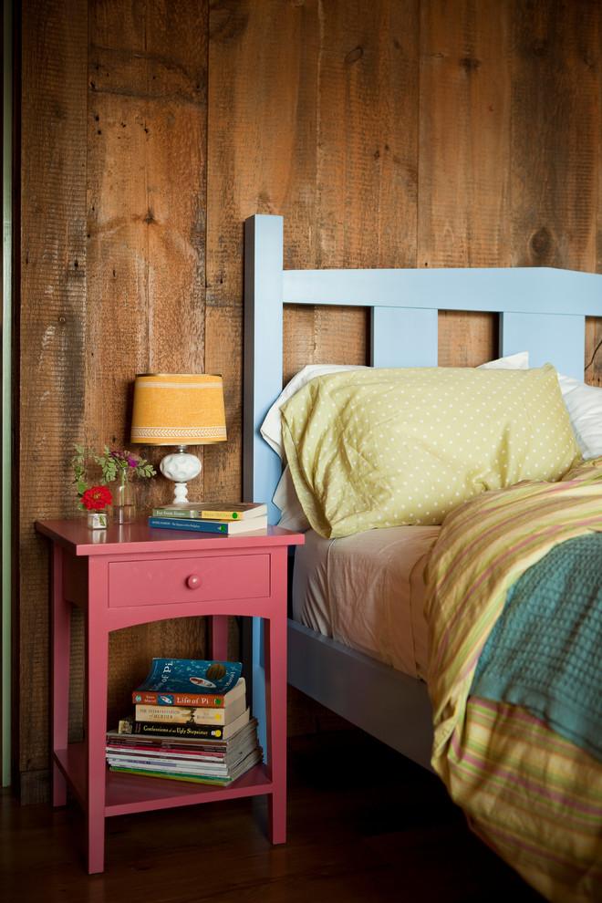 Inspiration for a rustic brown floor bedroom remodel in Portland Maine