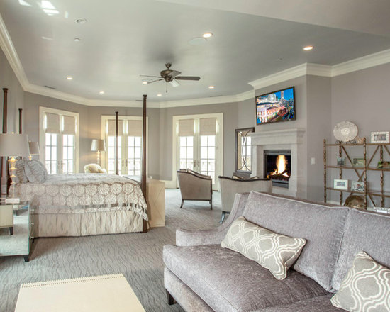 Parade of Homes - Cast stone fireplace mantel in bedroom with floating or raised hearth.