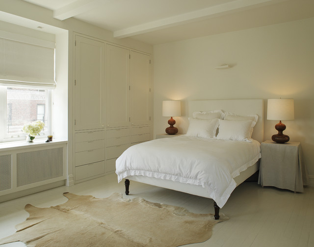 example of a minimalist painted wood floor and white floor bedroom design in new york with