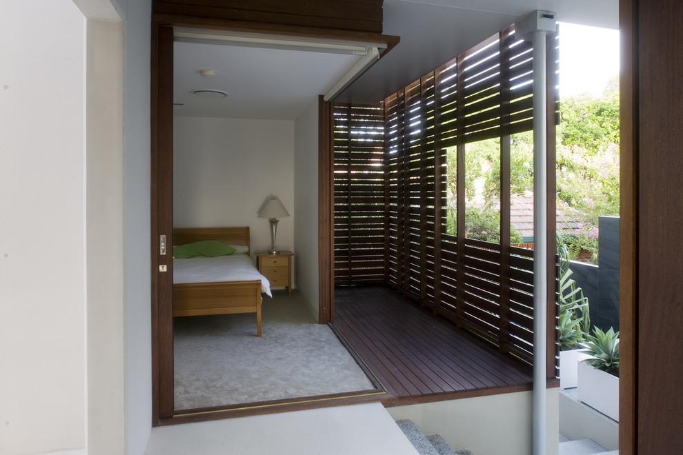 Example of a trendy bedroom design in Brisbane