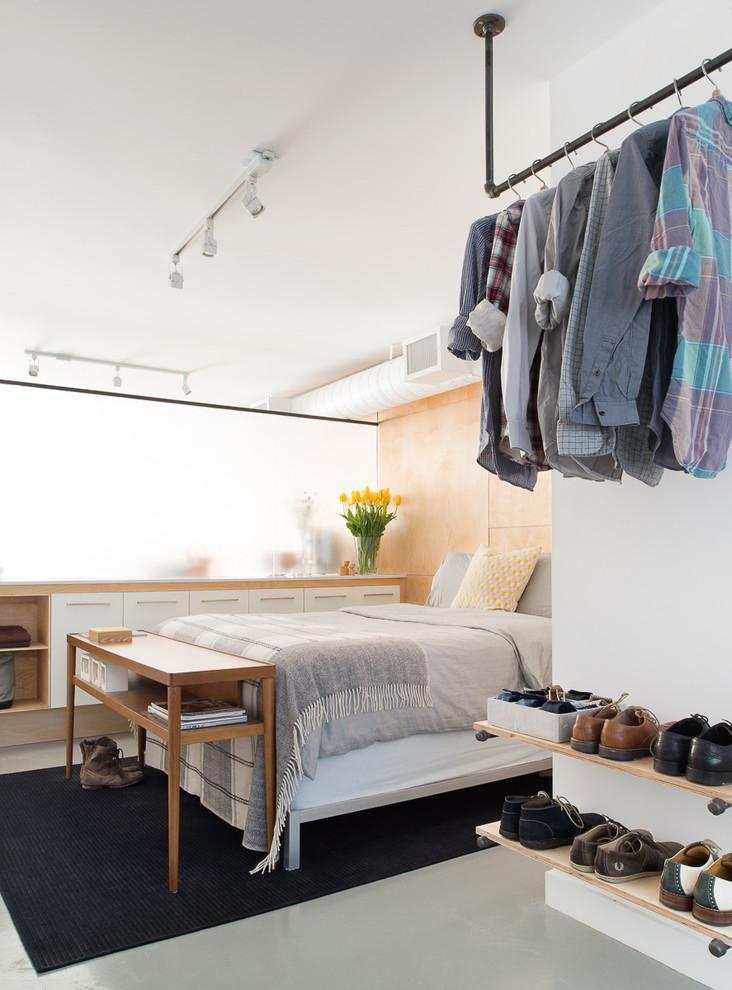 Bedroom - industrial bedroom idea in Toronto with white walls