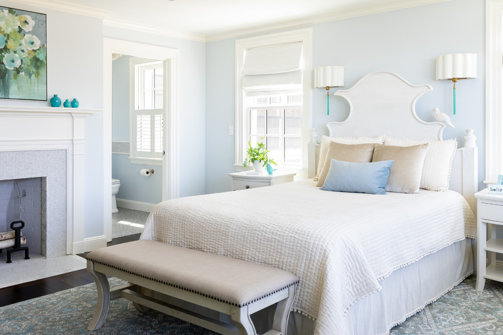 Inspiration for a coastal master dark wood floor bedroom remodel in Boston with a standard fireplace and a tile fireplace