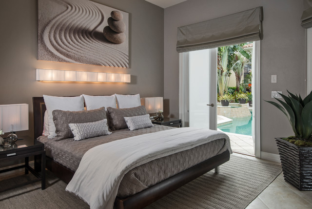 Example Of A Trendy Master Bedroom Design In Miami With Gray Walls And No Fireplace