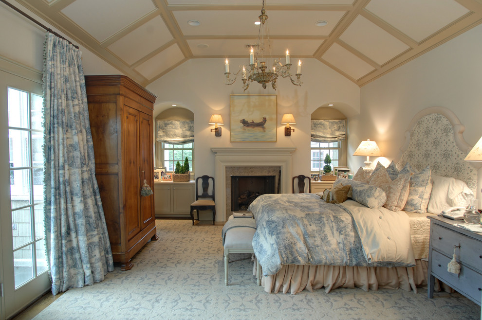 Ornate bedroom photo in Houston with white walls and a standard fireplace