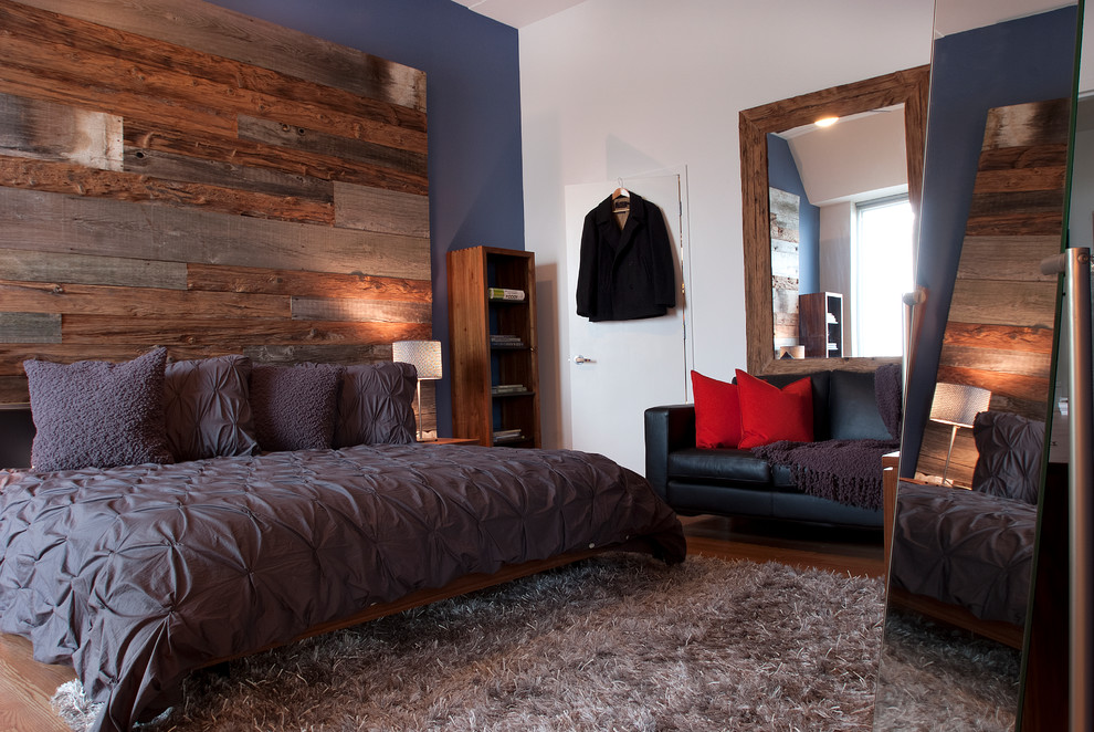 Example of a trendy bedroom design in Philadelphia with blue walls