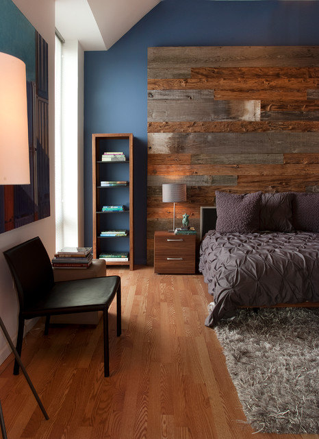 Inspiration for a contemporary medium tone wood floor bedroom remodel in Philadelphia with blue walls