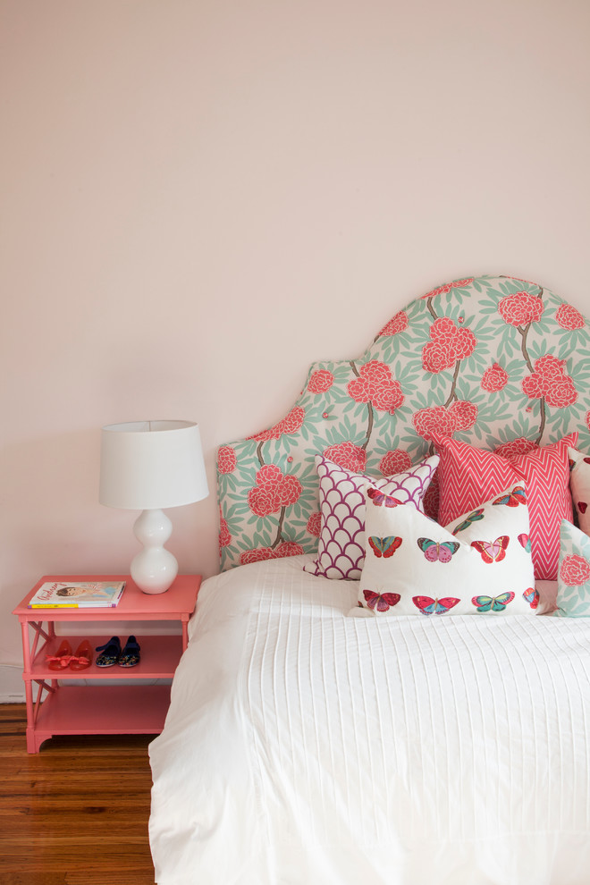 Example of an eclectic medium tone wood floor bedroom design in Philadelphia with beige walls