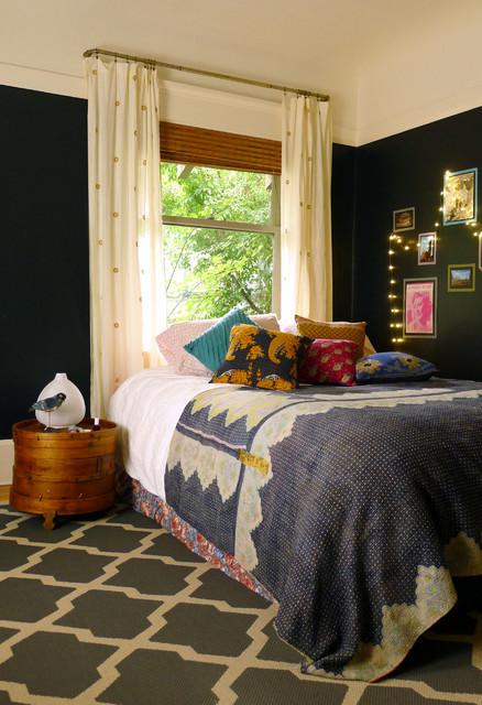 Bedroom - eclectic medium tone wood floor bedroom idea in San Francisco with black walls