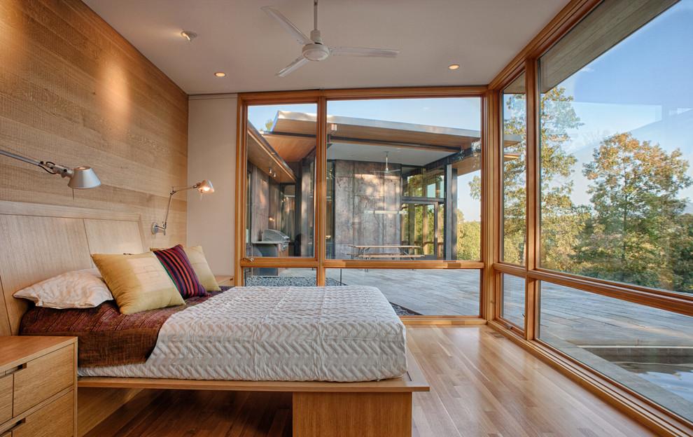 Trendy master medium tone wood floor and beige floor bedroom photo in Charlotte with beige walls