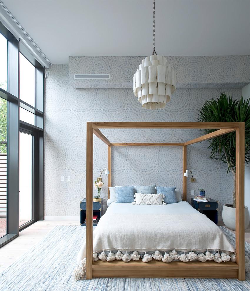 Bedroom - contemporary master light wood floor bedroom idea in New York with multicolored walls