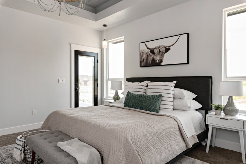 Example of a country carpeted bedroom design in Other with gray walls