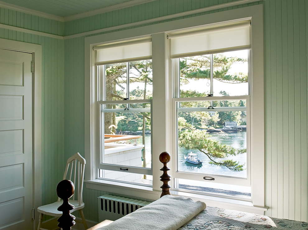 Example of a beach style bedroom design in Portland Maine with green walls