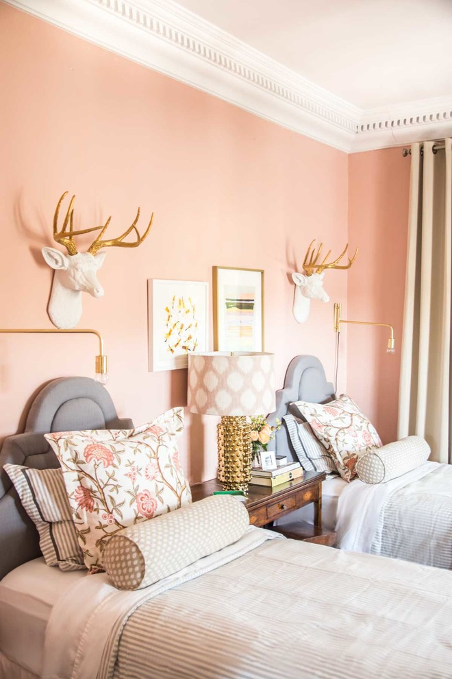 Example of a mid-sized eclectic guest bedroom design in Atlanta with pink walls