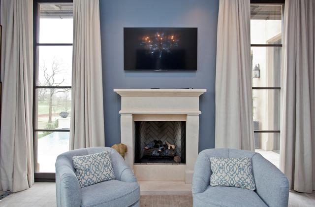 Large transitional master carpeted bedroom photo in Other with a standard fireplace and a stone fireplace