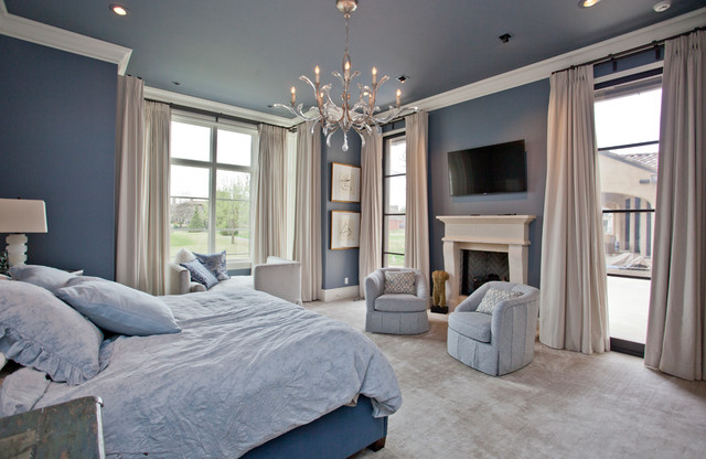 Inspiration for a large transitional master carpeted bedroom remodel in Other