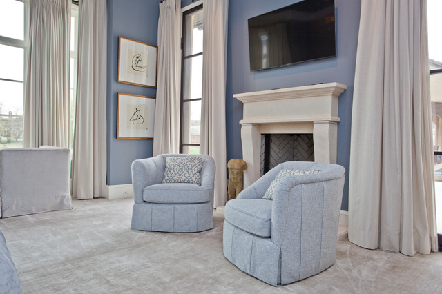 Inspiration for a large transitional master carpeted bedroom remodel in Other with a standard fireplace and a stone fireplace