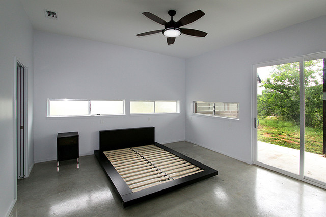 Example of a minimalist bedroom design in Austin