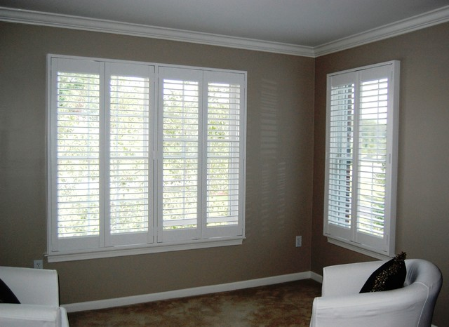 Plantation shutters traditional bedroom boston by for Decorating with plantation shutters