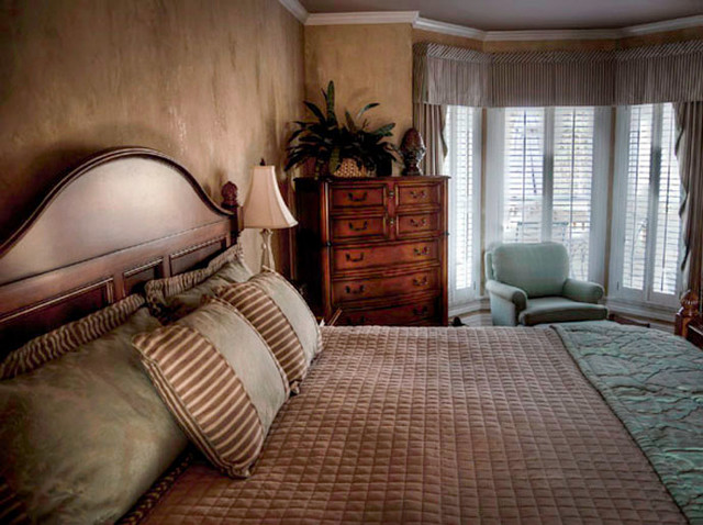 plaster walls with warm color glaze and metallic highlights