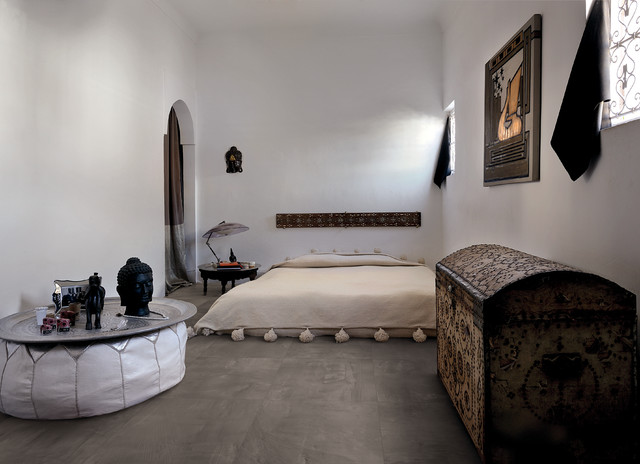 Inspiration for a large mediterranean guest ceramic floor bedroom remodel in Other with white walls and no fireplace