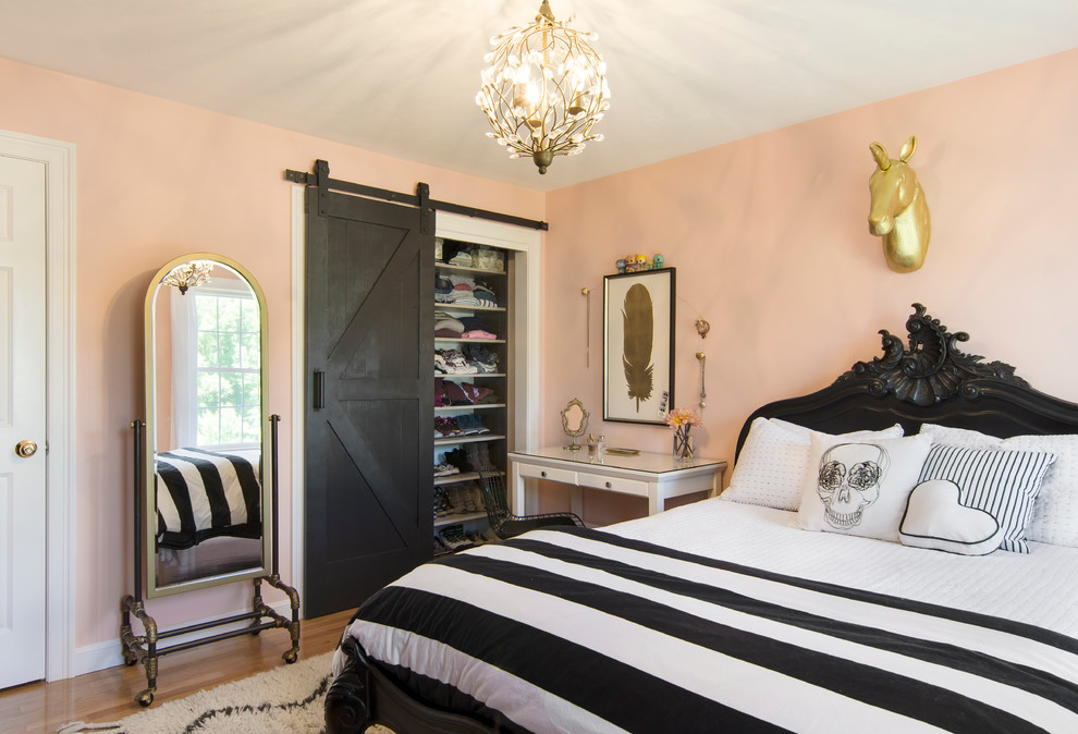 Mid-sized cottage guest medium tone wood floor bedroom photo in Boston with pink walls and no fireplace