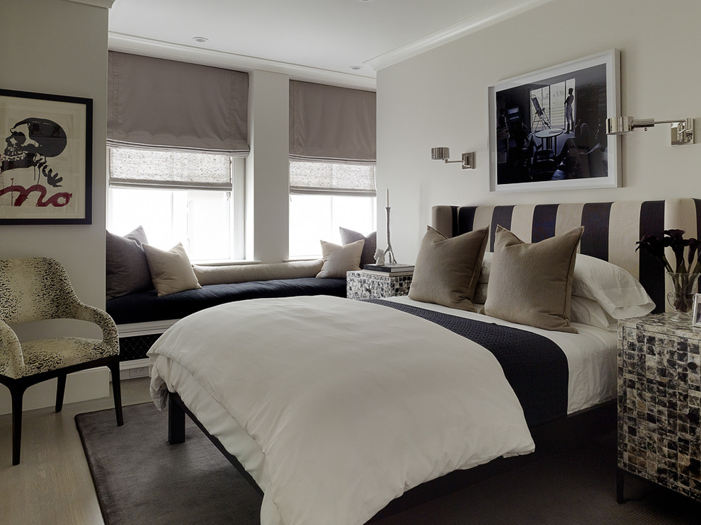 Eclectic light wood floor bedroom photo in San Francisco with gray walls and no fireplace