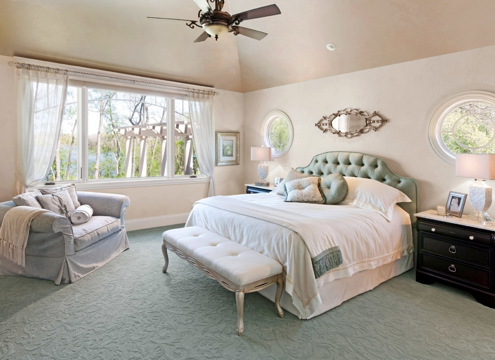 Example of a classic master carpeted and green floor bedroom design in Milwaukee with beige walls and no fireplace
